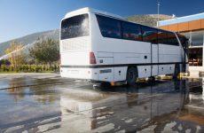 Tourist bus wash, water spraying from a garden hose